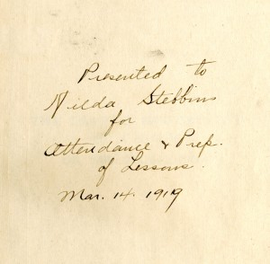 "Fig. 2. Inside cover inscription. ""Presented to Hilda Stebbins for Attending + Prep. of Lessons. March 14, 1919"""